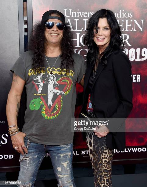 Slash and Meegan Hodges arrive at the Opening Night of Universal Studios' Halloween Horror Nights at Universal Studios Hollywood on September 12 2019...