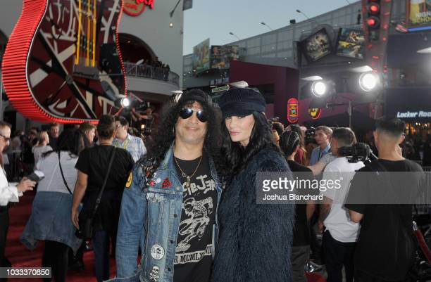 Slash and Meegan Hodges attend Halloween Horror Nights 2018 at Universal Studios Hollywood on September 14 2018 in Los Angeles California