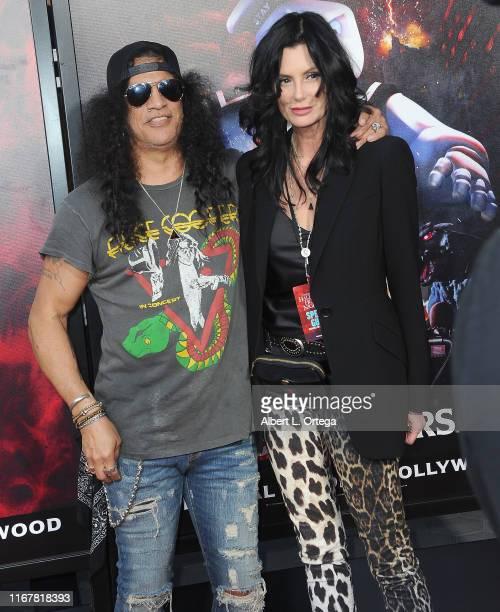 Slash and Meegan Hodges attend Opening Night Of Universal Studios' Halloween Horror Nights held at Universal Studios Hollywood on September 12, 2019...