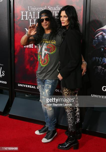 Slash and Meegan Hodges attend the opening night of Universal Studios' Halloween Horror Nights held at Universal Studios Hollywood on September 12...