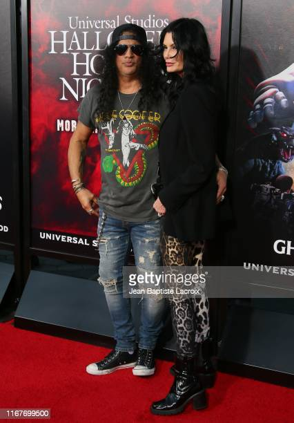 Slash and Meegan Hodges attend the opening night of Universal Studios' Halloween Horror Nights held at Universal Studios Hollywood on September 12,...