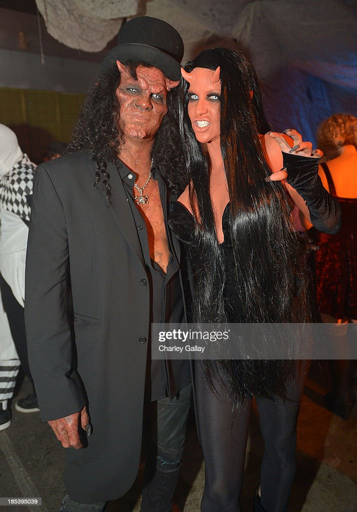 Slash and Perla Hudson attend MAC Cosmetics and Rick Baker's Monster Mash on October 19, 2013 in Glendale, California.
