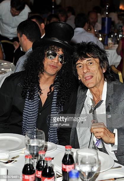 Slash and Ronnie Wood attend the 35th Nordoff Robbins 02 Silver Clef Awards at London Hilton on July 2 2010 in London England