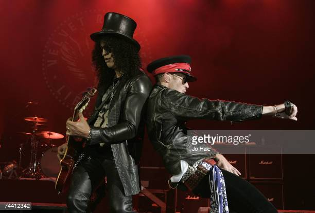 Slash and Scott Weiland of Velvet Revolver perform at the Apollo Hammersmith June 5 2007 in London England