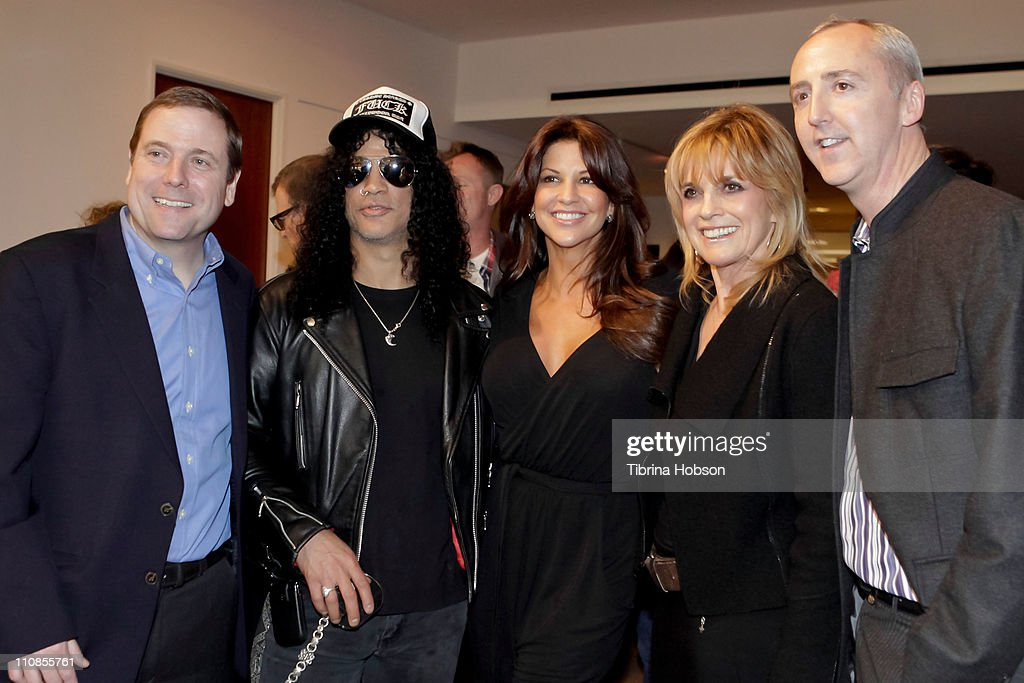 Slash and wife Perla Hudson host an exclusive VIP gala preview at the Julien's Auctions Gallery on March 24, 2011 in Beverly Hills, California.