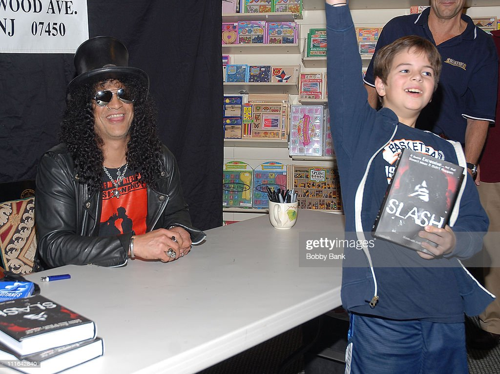 Slash and young fan at the 'Slash' book signing at Bookends Bookstore on November 1, 2007 in Ridgewood, New Jersey.