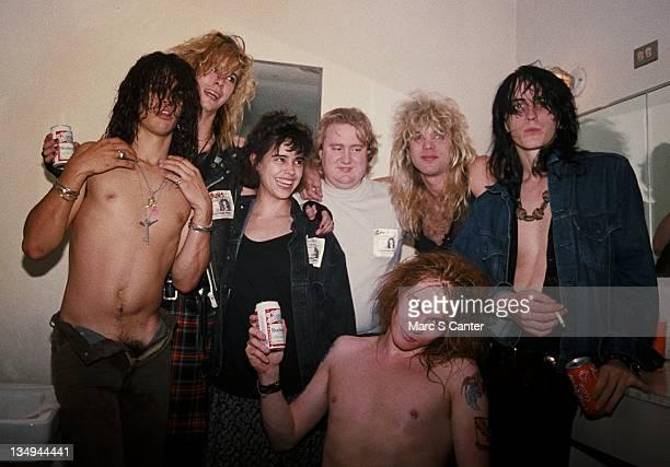 Slash, Duff McKagan, Teresa Ensenat , Tom Zutaut , Axl Rose , Steven Adler and Izzy Stradlin of the rock group 'Guns n' Roses' backstage at the Santa...