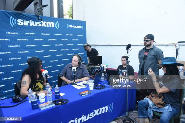 Slash, Eddie Trunk and Meegan Hodges attend SiriusXM Volume Presents Eddie Trunk Live at The Rainbow on August 3, 2018 in Los Angeles, California.