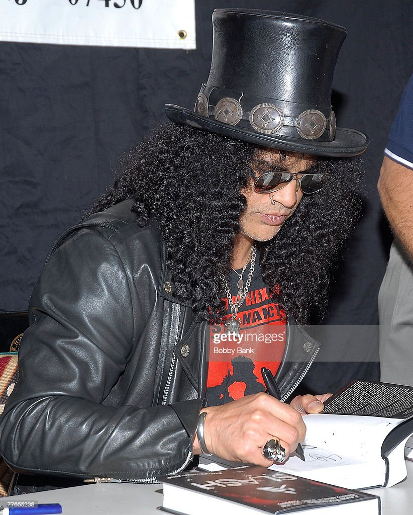 Slash guitarist for Guns N' Roses and Velvet Revolver signs copies of his book 'Slash' at Bookends Bookstore on November 1, 2007 in Ridgewood, New Jersey.