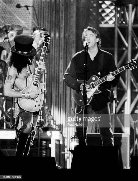 Slash left and Boz Scaggs performing onstage at the opening of the Rock and Roll Hall of Fame at Browns Stadium Cleveland Ohio September 25 1995