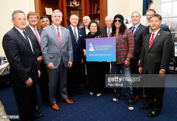 Slash of Guns N' Roses poses for a photo with members of Congress at the SLASH Holiday Reception hosted by The Recording Arts and Sciences...