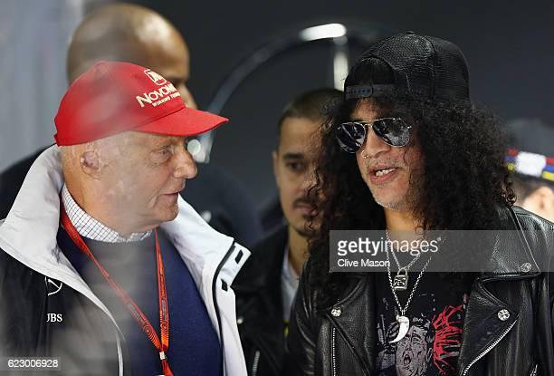 Slash of Guns n Roses with Mercedes GP nonexecutive chairman Niki Lauda in the Mercedes garage before the Formula One Grand Prix of Brazil at...