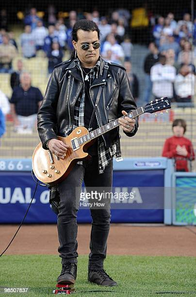 Slash of The Guns N Roses performs the national anthem before the game between the Los Angeles Dodgers and the San Francisco Giants at Dodger Stadium...