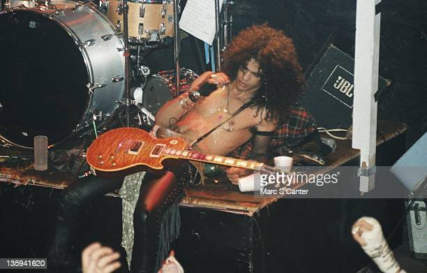 Slash of the rock band Guns n' Roses performs onstage at the Troubadour on the night that Tom Zutaut of Geffen Records was in attendance who would...