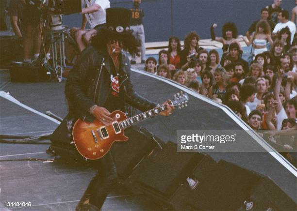 Slash of the rock group 'Guns n' Roses' open for Aerosmith and Deep Purple as they performs onstage at Giants Stadium on August 16 1988 in East...