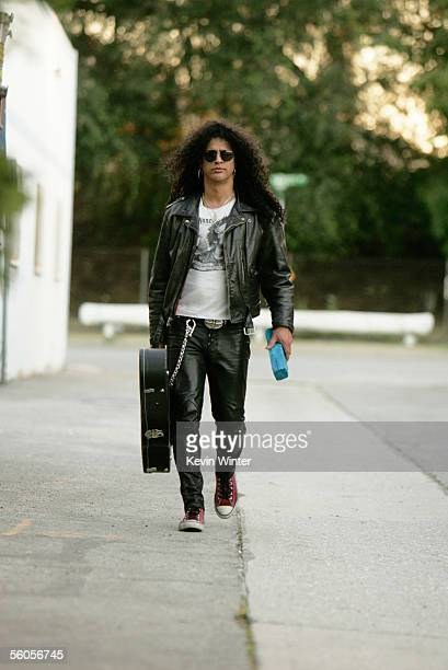 Slash of Velvet Revolver walks with the symbolic blue brick as they record and film the video for the new disaster relief charity single a cover of...