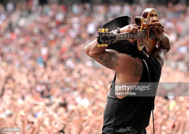 Slash performs on stage playing the guitar behind his head at The Soundwave Music Festival at Olympic Park on 27th February 2011 in Sydney Australia