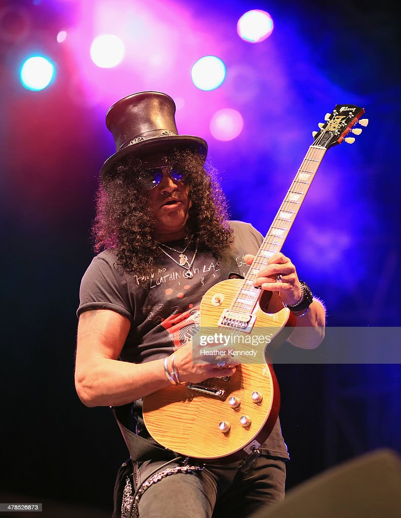 Slash performs onstage during the USPS Hendrix Stamp Event + Los Lonely Boys during the 2014 SXSW Music, Film + Interactive at Butler Park on March 13, 2014 in Austin, Texas.