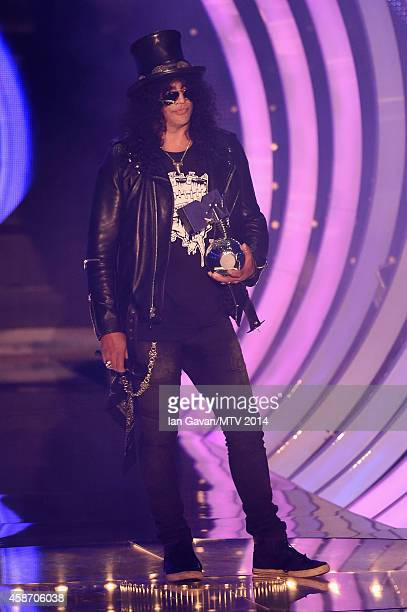Slash presents the Global Icon award to Ozzy Osbourne performs on stage during the MTV EMA's 2014 at The Hydro on November 9 2014 in Glasgow Scotland