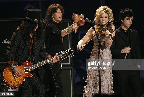 Slash Steve Tyler Alison Krauss and Billie Joe Armstrong perform a Tsunami Relief number during the 47th Annual Grammy Awards at the Staples Center...