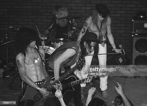 Slash Steven Adler Axl Rose and Izzy Stradlin of the rock band 'Guns n' Roses' perform onstage at the Troubadour where they played 'Rocket Queen' for...