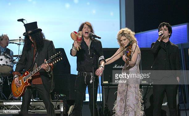 Slash Steven Tyler Alison Krauss and Billie Joe Armstrong perform Across the Universe for the Tsunami Relief performance Photo by Kevin...