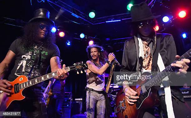 Slash Steven Tyler and Joe Perry perform onstage during Aerosmith's summer 'Let Rock Rule' tour launch at Whisky a Go Go on April 8 2014 in West...