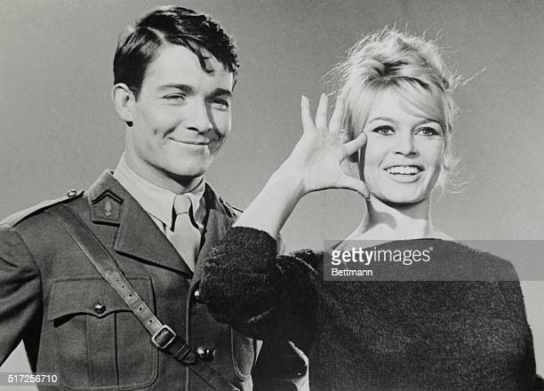 Slated to become a war heroine on the screen that is French movie actress Brigitte Bardot previews with a salute her role in the forthcoming film...