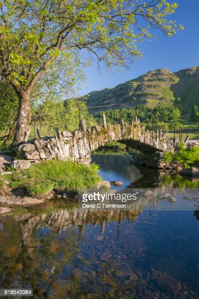 slater's bridge reflected in the river brathay, little langdale, lake district national park, cumbria, england, uk - english lake district stock pictures, royalty-free photos & images