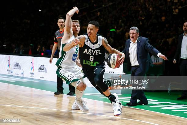 J Slaughter of ASVEL Lyon Villeurbanne is going to the basket against Heiko Schaffartzik of Nanterre 92 during the Jeep¨ ELITE match between Nanterre...