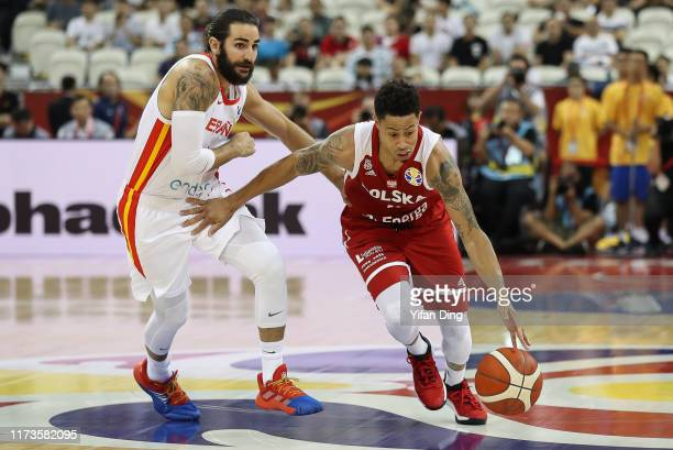 J Slaughter of Poland dribbles against Ricky Rubio of Spain during the quarter final match between Spain and Poland of 2019 FIBA World Cup at...