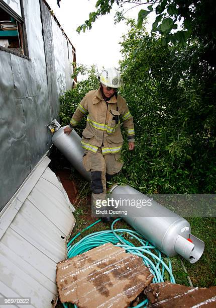 Slaughterville Assistant Fire Chief Jimmy Blair checks propane tanks after a tornado struck the Prairie Creek Village trailer park May 11 2010 in...