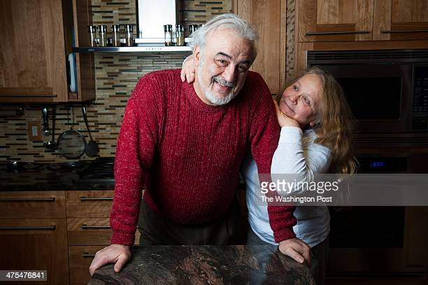 Slava and Rita Lazebnikov pose for a photograph in the kitchen that they redesigned Wednesday February 19 2014 in Rockville MD They also redesigned...