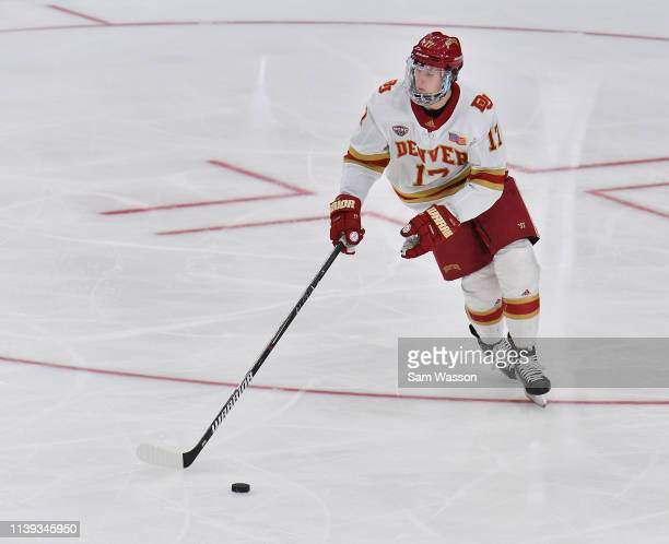 Slava Demin of the Denver Pioneers skates with the puck during his team's NCAA Division I Men's Ice Hockey West Regional Championship Semifinal game...