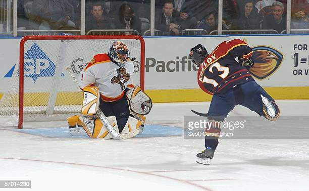 Slava Kozlov of the Atlanta Thrashers scores the winning goal against Roberto Luongo the Florida Panthers in the shootout March 6 2006 at Philips...