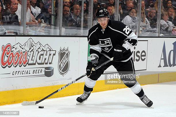 Slava Voynov of the Los Angeles Kings skates with the puck against the Vancouver Canucks in Game Four of the Western Conference Quarterfinals during...