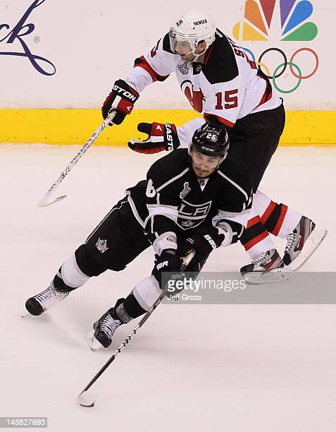 Slava Voynov of the Los Angeles Kings skates with the puck against Petr Sykora of the New Jersey Devils during Game Four of the 2012 Stanley Cup...