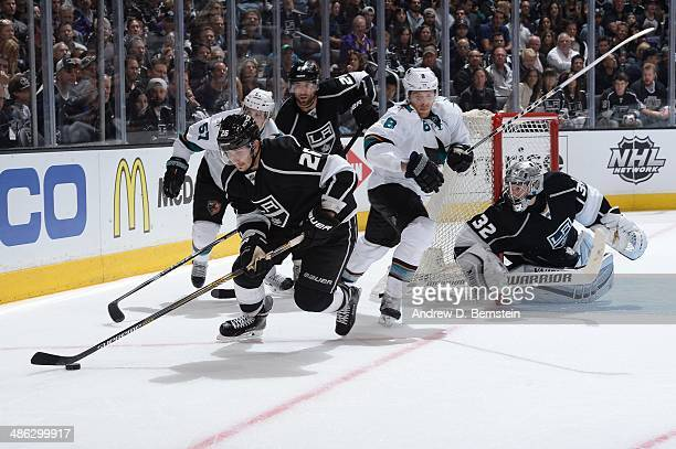 Slava Voynov of the Los Angeles Kings skates with the puck against Tommy Wingels and Joe Pavelski of the San Jose Sharks in Game Three of the First...