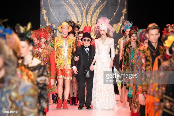 Slava Zaitsev walks the runway during the finale of the Slava Zaitsev fashion show at Mercedes Benz Fashion Week Russia Fall/Winter 2018/19 at Manege...