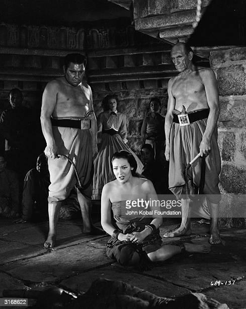 Slave girl Tuptim played by Linda Darnell is punished for attempting to escape in a scene from 'Anna and the King of Siam' directed by John Cromwell