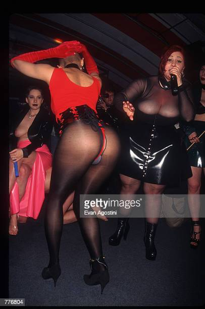 A slave is auctioned off at the third Black Blue Ball fetish event May 3 1996 in New York City Hosted by subculture personality Mistress Carrie the...