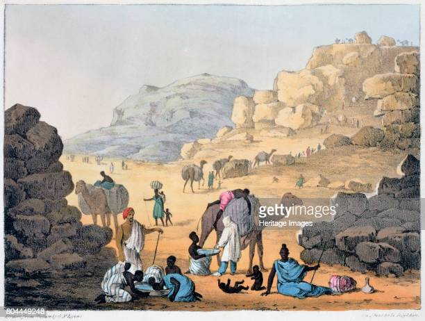 A Slave Kaffle' 1821 A kaffle or coffle means a group of animals prisoners or slaves chained together Illustration from 'Narrative of Travels in...