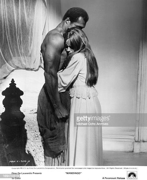 Slave Ken Norton is hugged by Susan George in a scene from the film 'Mandingo' 1975