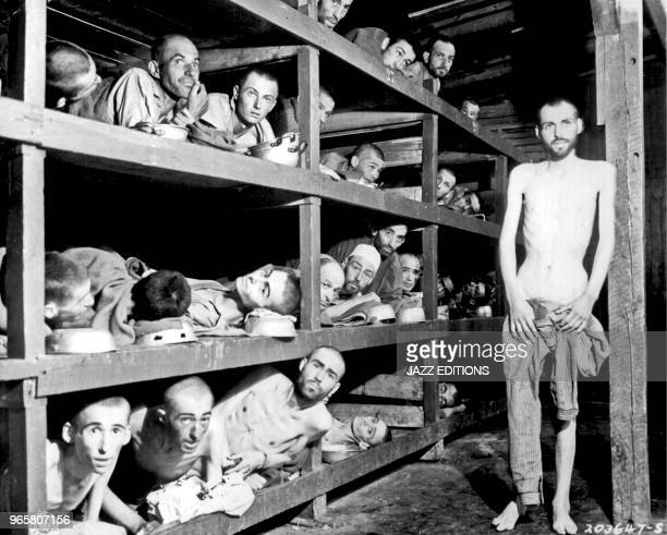 Slave laborers in the Buchenwald concentration camp near Jenamany had died from malnutrition when US troops of the 80th Division entered the camp...