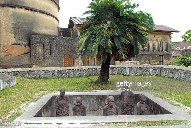 Slave Market Memorial at Stone Town Sculpture of chained slaves stands as a memorial at the site of the old Slave Market in Zanzibar Tanzania