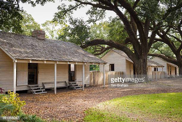 Slave quarters at Oak Alley plantation antebellum mansion house by Mississippi at Vacherie Louisiana USA