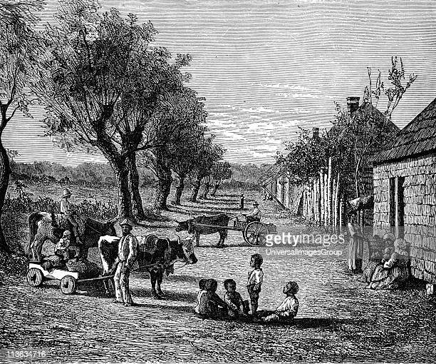 Slave quarters on a plantation in Georgia USA Wood engraving c1860