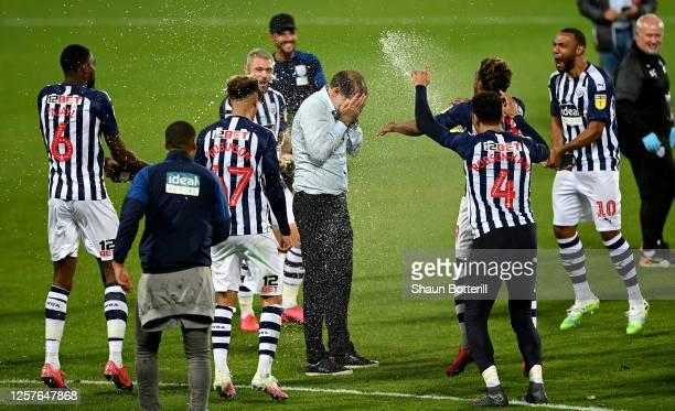 Slaven Bilić , head coach of West Bromwich is showered with champaign after the Sky Bet Championship match between West Bromwich Albion and Queens...