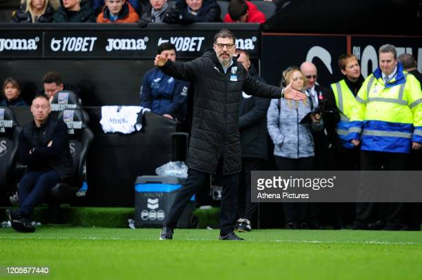 Slaven Bili Manager of West Bromwich Albion shouts instructions to his team from the dugout during the Sky Bet Championship match between Swansea...