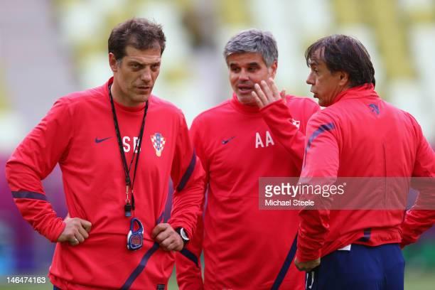 Slaven Bilic coach of Serbia looks on alongside assistants Aljosa Asanovic and Nikola Jurcevic of Croatia during a UEFA EURO 2012 training session at...